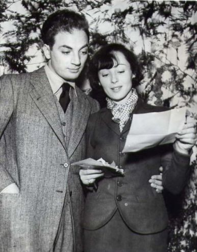 On their wedding day, Clifford Odets and Luise Rainer read messages from friends