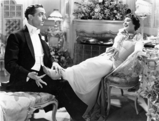 William Powell and Luise Rainer share a light-hearted moment as Flo Ziegfeld and Anna Held