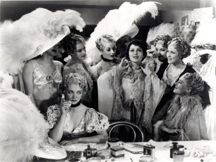 Virginia Bruce (seated) and Luise Rainer, with the Ziegfeld Girls