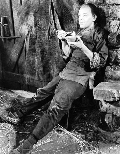 Paul Muni takes a break on the set of The Good Earth (1937)