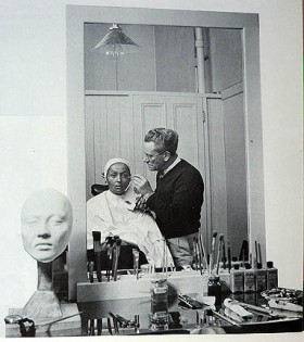 Luise Rainer in the make-up room with make-up artist Cecil Holland applying her subtle transformation for The Good Earth
