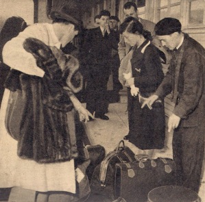 Luise and Robert sorting out their luggage after arriving in Paris in 1946.