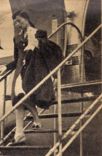 Luise Rainer descends the steps from the plane as she arrives in Paris, 1946.