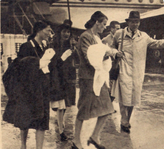 Francesca is carried by her nanny (centre) as Luise and Robert arrive in Paris, 1946.