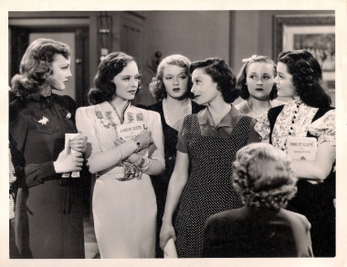 """WERE YOU TALKING ABOUT ME AGAIN?... Luise Rainer asks Paulette Goddard in this scene with Virginia Grey, Lana Turner, Dorothy Granger and Ann Rutherford for Metro-Goldwyn-Mayer's """"Dramatic School,"""" produced by Melvyn LeRoy and directed by Robert Sinclair."""