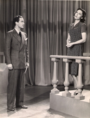"""TIS BUT THY NAME THAT IS MY ENEMY... Luise Rainer rehearses with Anthony Allen in this classroom scene for Metro-Goldwyn-Mayer's """"Dramatic School,"""" produced by Melvyn LeRoy and directed by Robert Sinclair."""