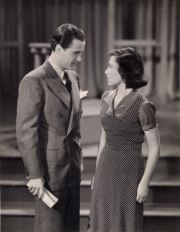 """SHALL I HEAR MORE?... Anthony Allen rehearses with Luise Rainer in this classroom scene fro Metro-Goldwyn-Mayer's """"Dramatic School,"""" produced by Melvyn LeRoy and directed by Robert Sinclair."""