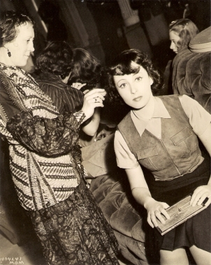 Luise Rainer and unknown make-up artist on the set of Dramatic School (1938)