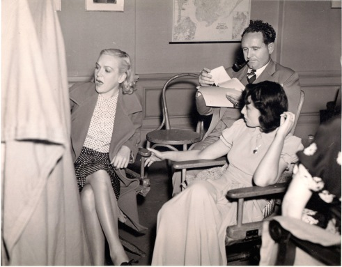 Luise Rainer (right), with director Frank Borage and unknown woman on the set of Big City (1937)