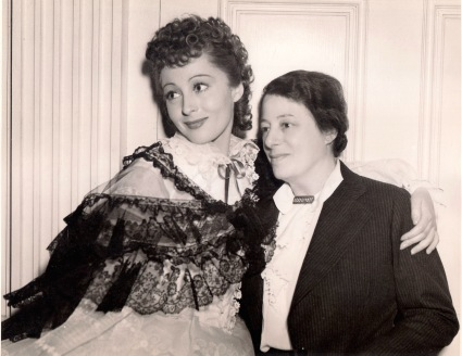 """LUISE RAINER AND HER MOTHER. Mrs. Emy Rainer, visiting the star on the set of M-G-M's """"The Toy Wife,"""" in which she has the title role. This is the second visit to Hollywood for Mrs. Rainer, who accompanied her daughter when the latter arrived from Vienna nearly three years ago. At present she makes her home in Brussels. [Publicity photo with original caption, April 1938]"""
